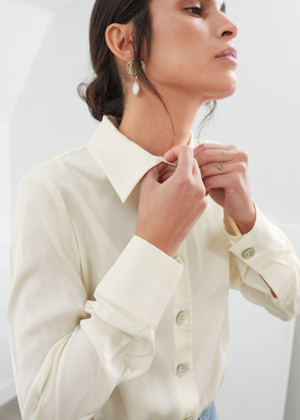 Model front image of Stories iridescent shell button satin blouse in white