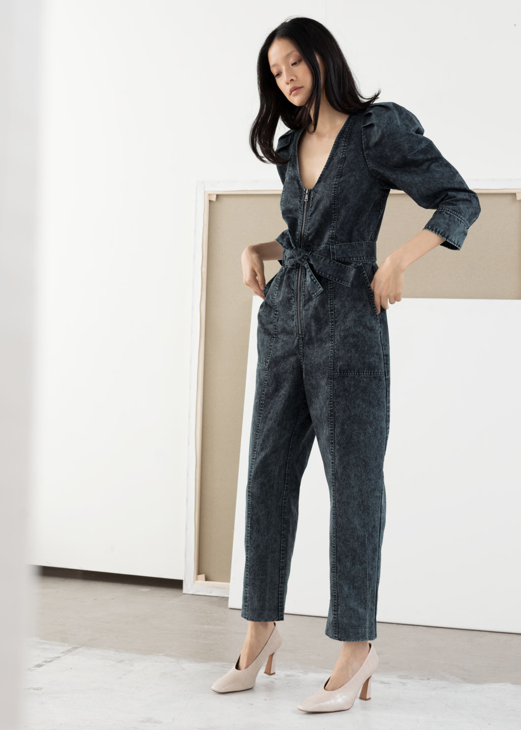 Model front image of Stories stonewash denim puff sleeve jumpsuit in black