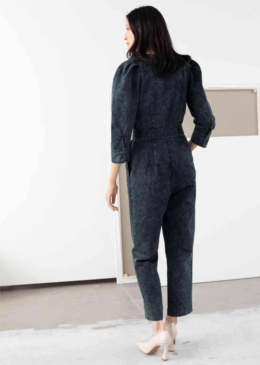 Model back image of Stories stonewash denim puff sleeve jumpsuit in black