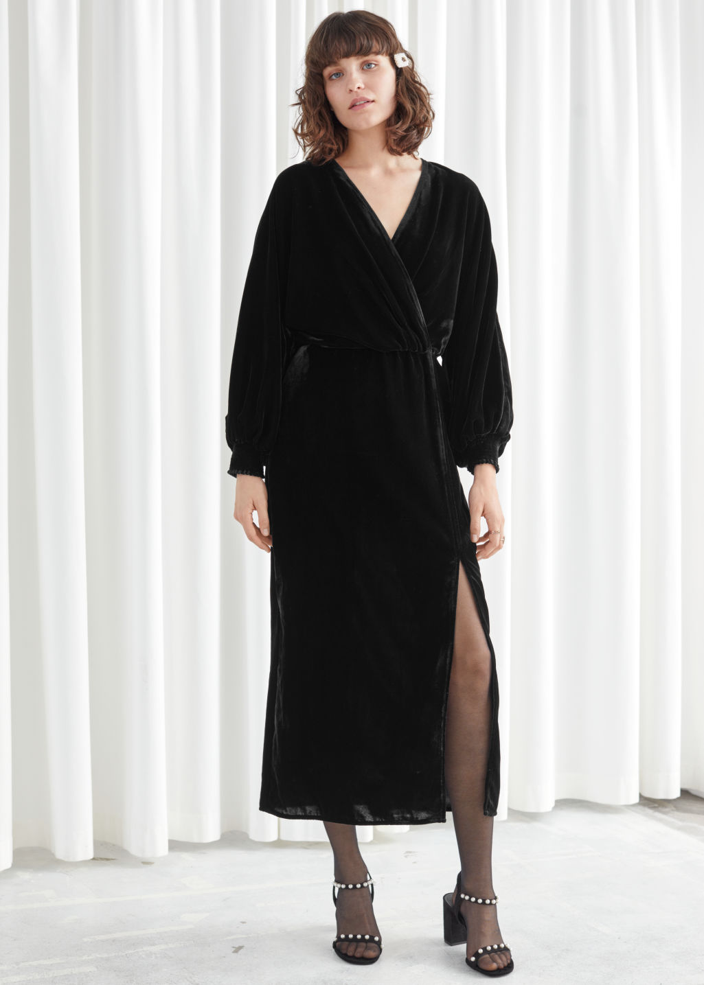 Model front image of Stories velvet side slit midi dress in black