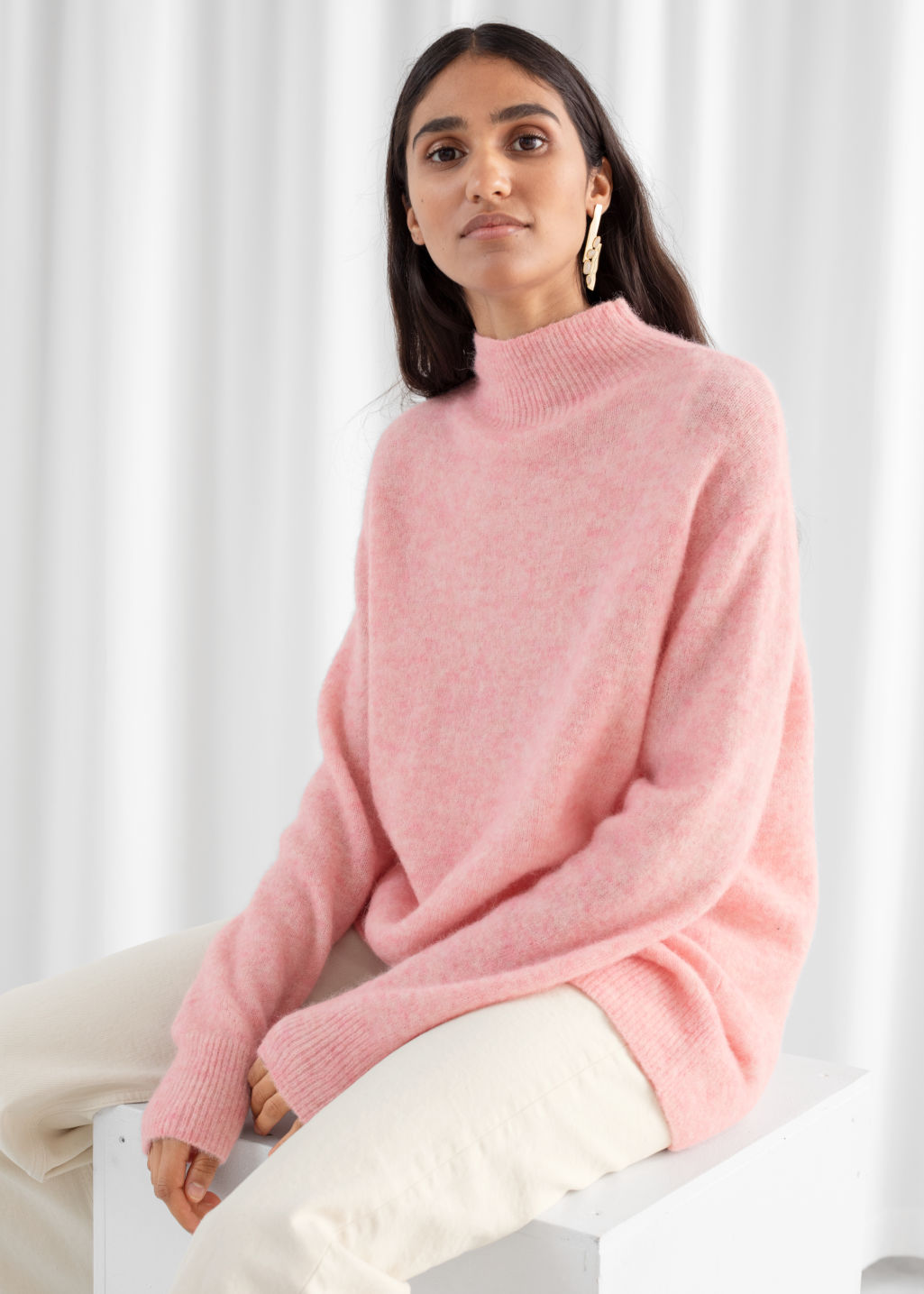 Model front image of Stories relaxed mock neck sweater in pink