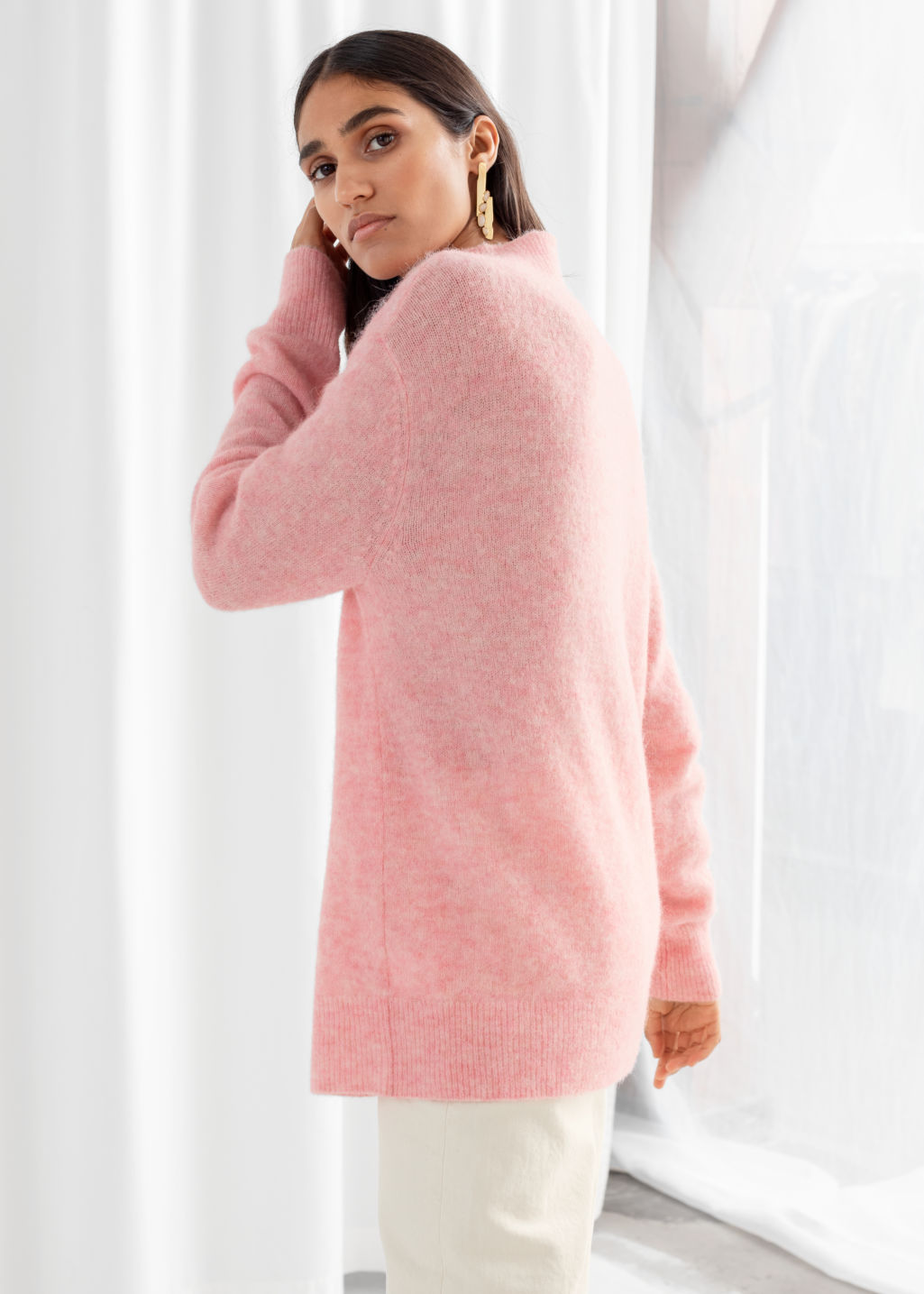 Model back image of Stories relaxed mock neck sweater in pink