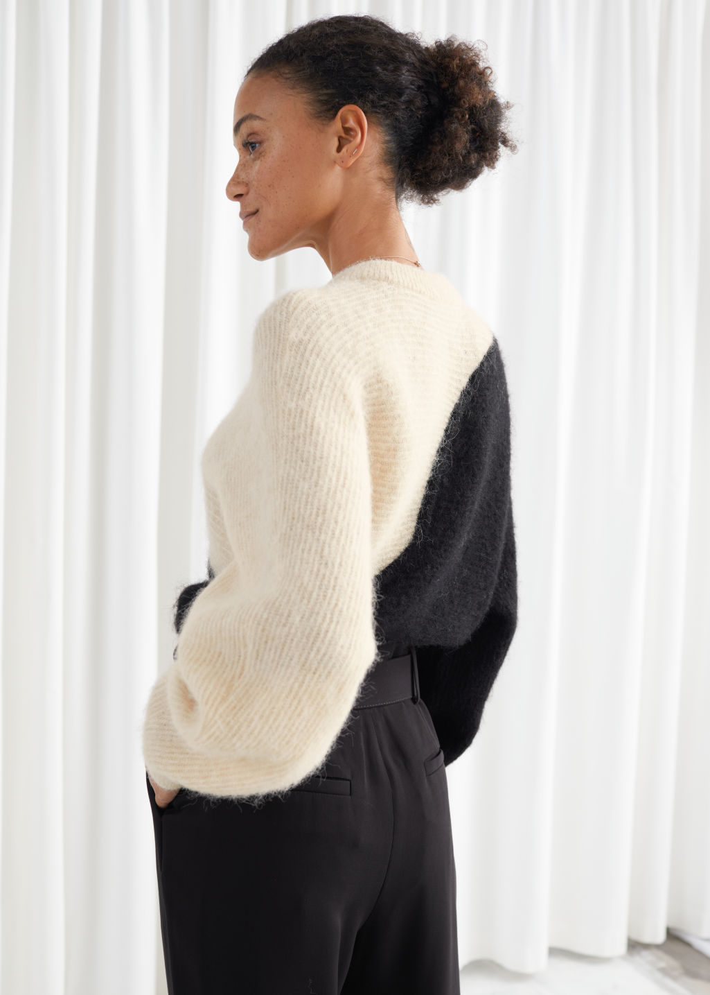 Model back image of Stories alpaca blend cropped colour block sweater in black
