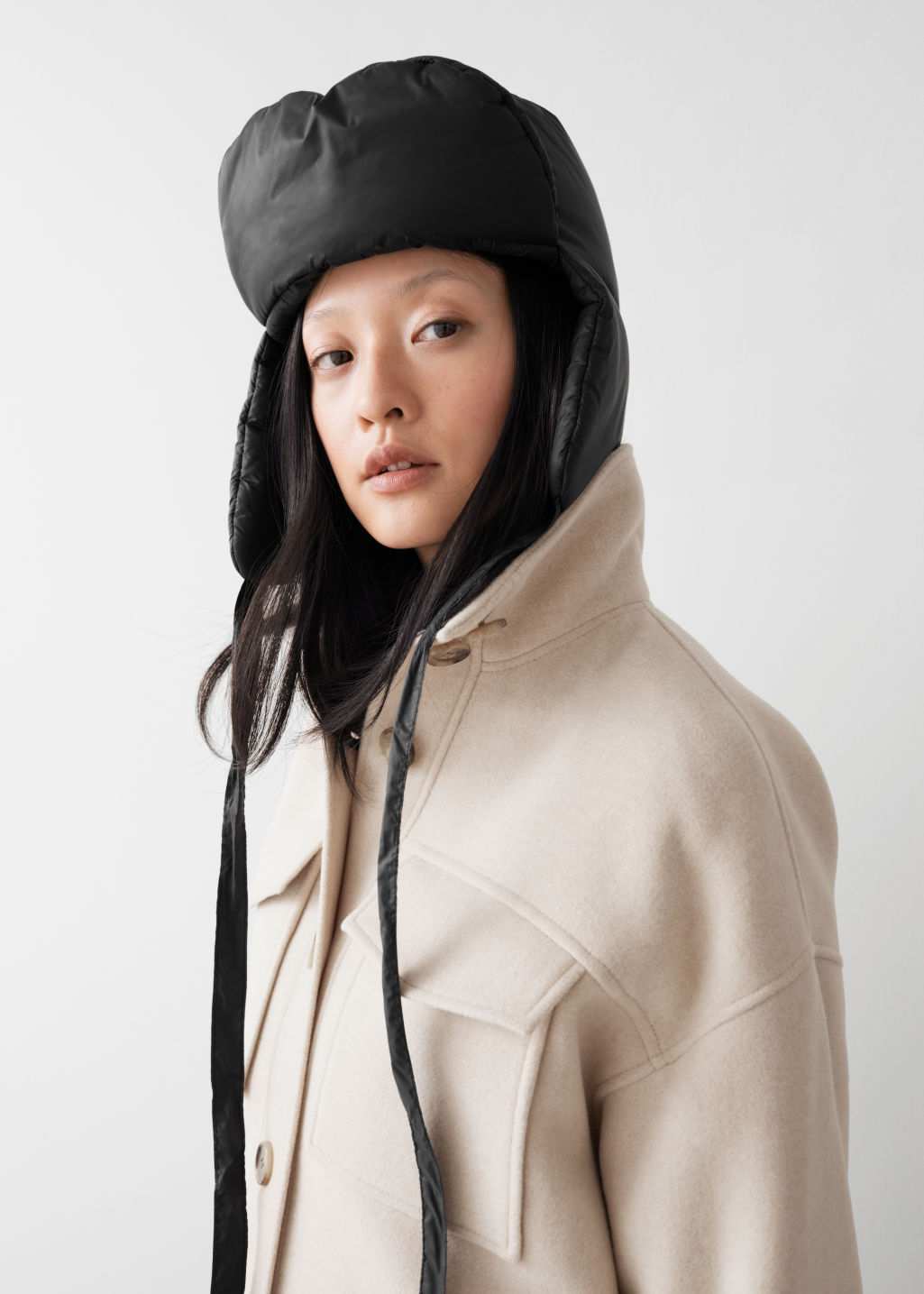Model front image of Stories padded aviator hat in black