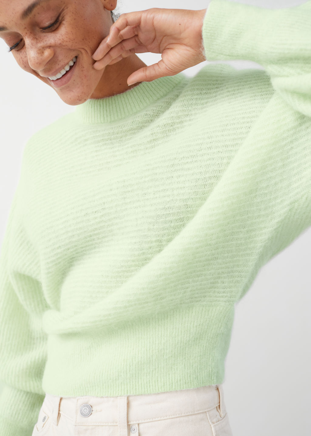 Model front image of Stories cropped wool blend puff sleeve sweater in green