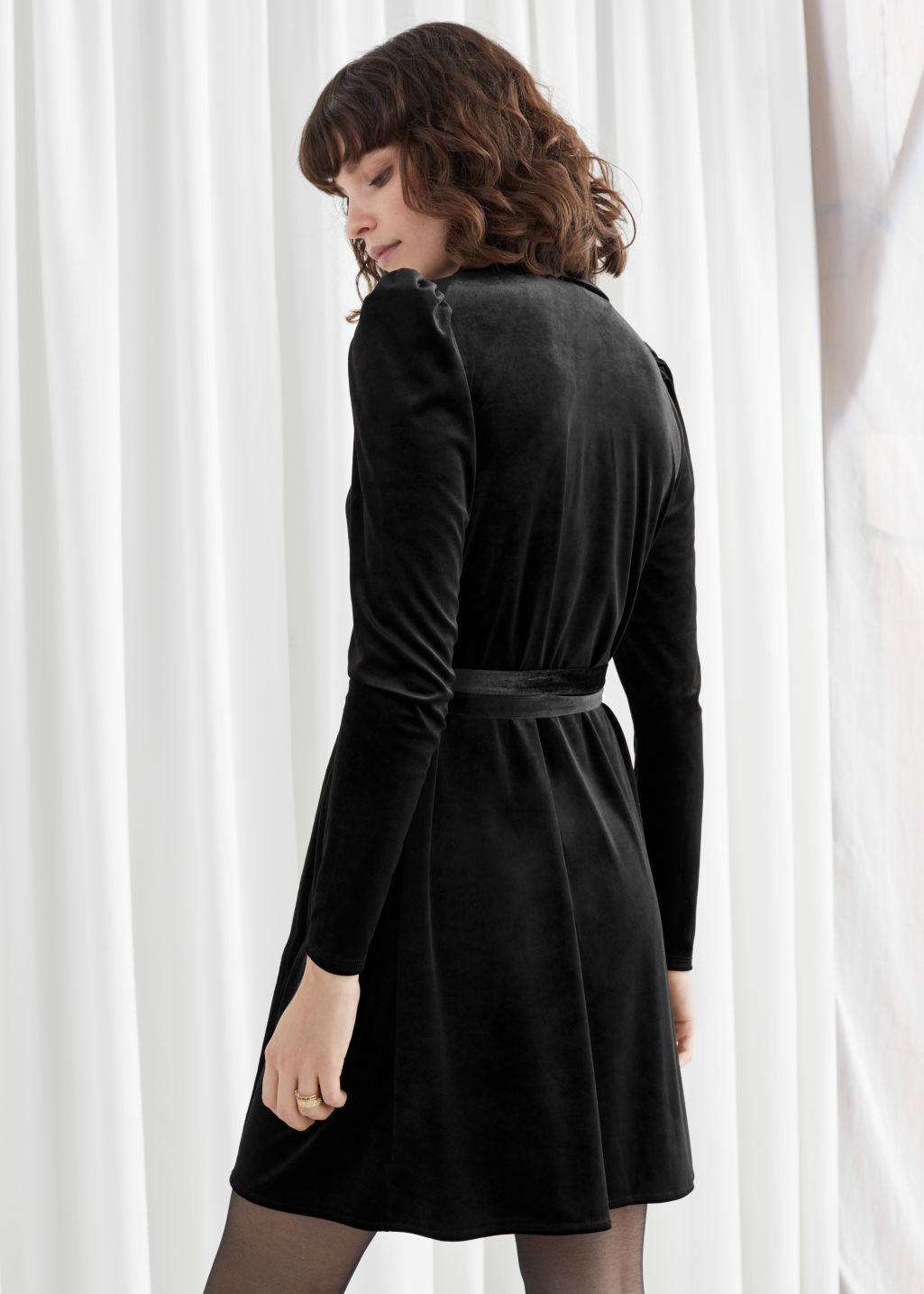 Model back image of Stories velvet mini wrap dress in black
