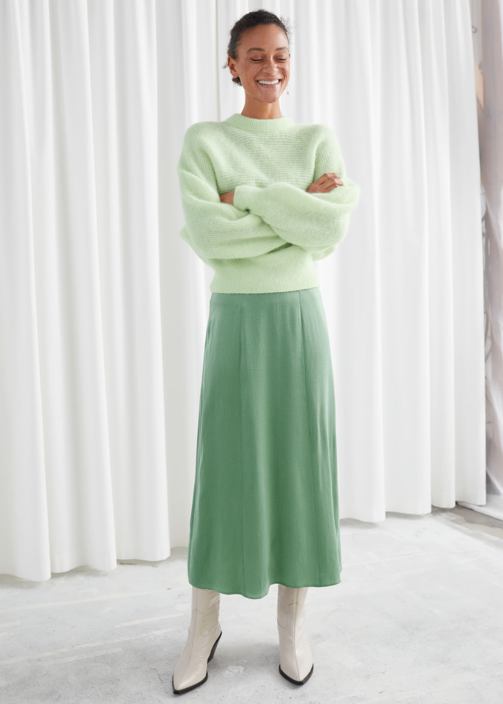 Model front image of Stories satin bias cut midi skirt in green