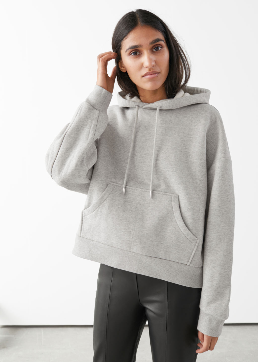 Model front image of Stories oversized boxy hooded sweatshirt in grey