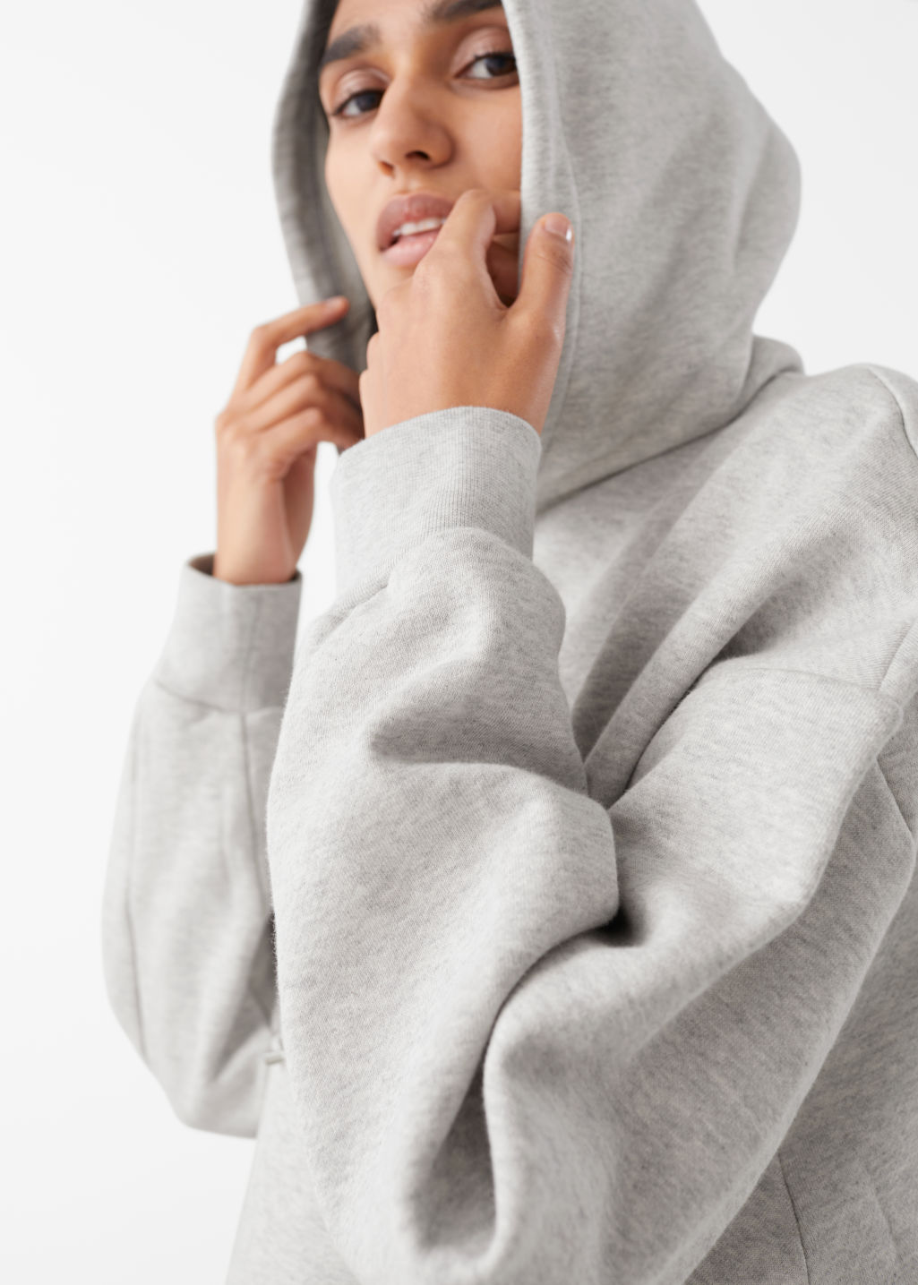 Model side image of Stories oversized boxy hooded sweatshirt in grey