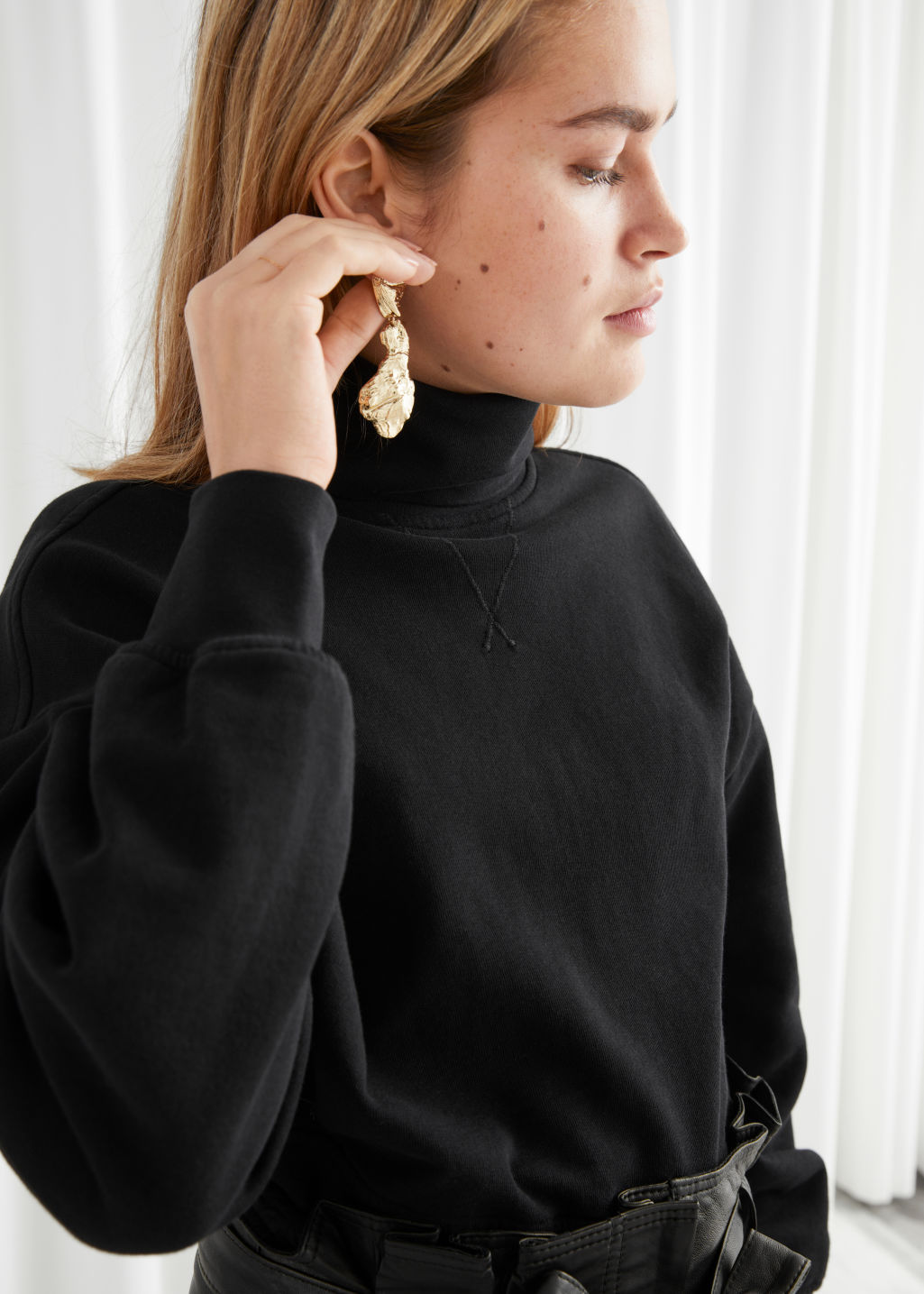 Model front image of Stories organic cotton turtleneck sweater in black