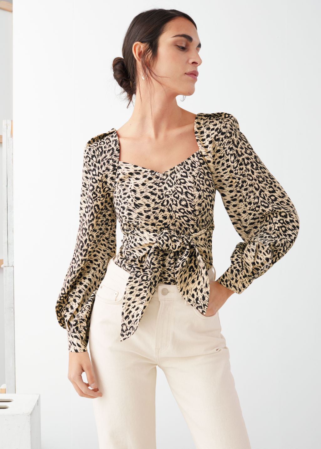 Model front image of Stories leopard knot tie blouse in black