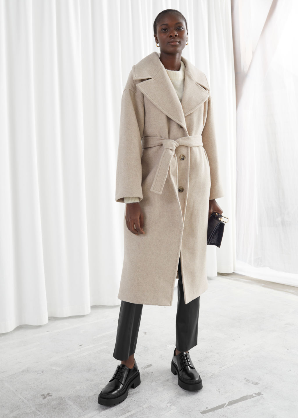 Model front image of Stories oversized wool blend belted coat in white