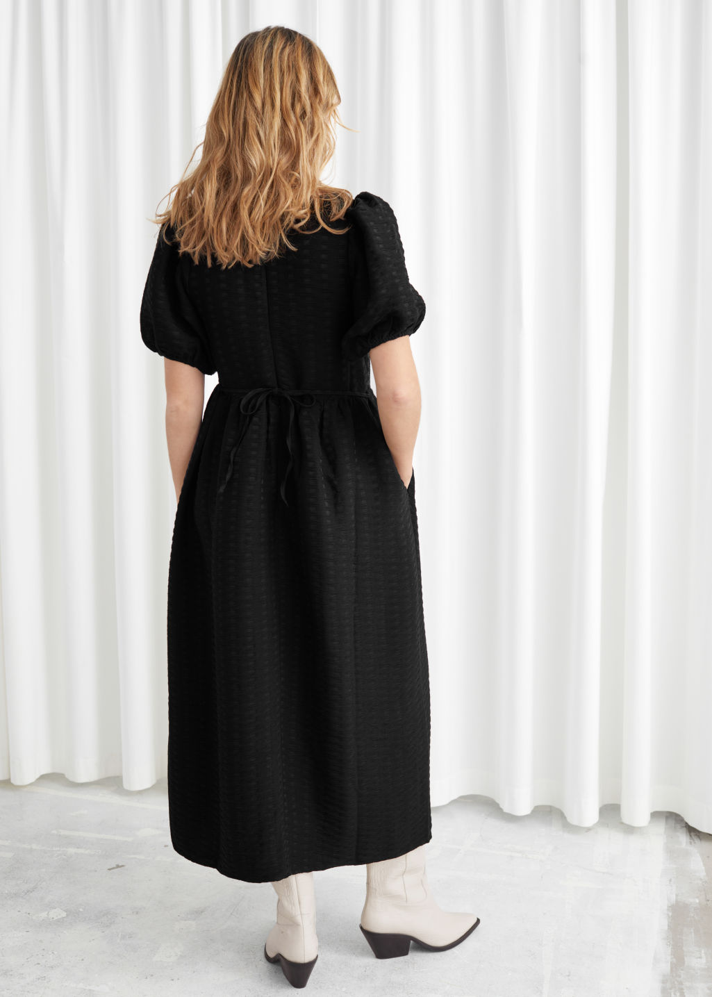 Model back image of Stories puff sleeve midi jacquard dress in black