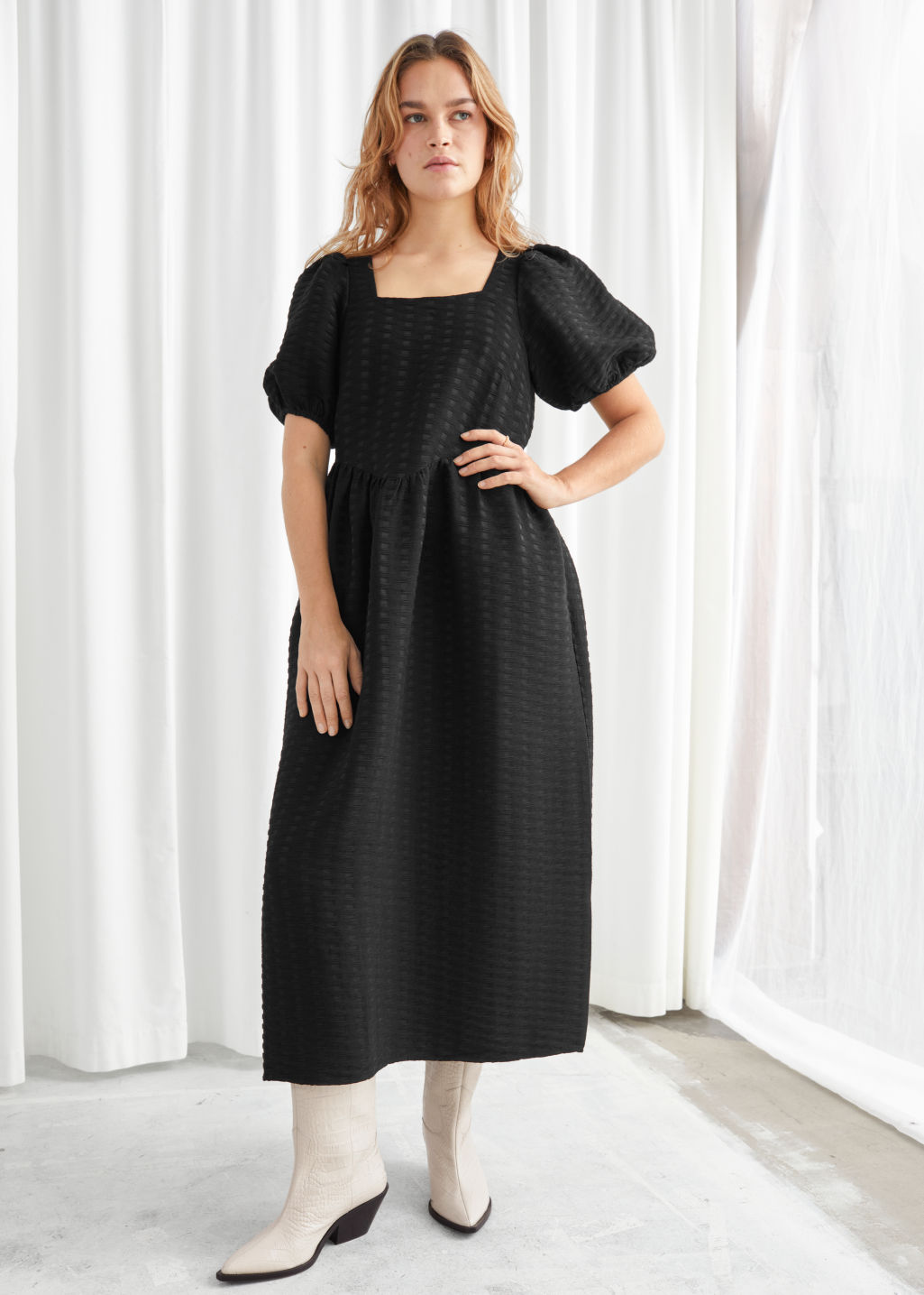 Model front image of Stories puff sleeve midi jacquard dress in black