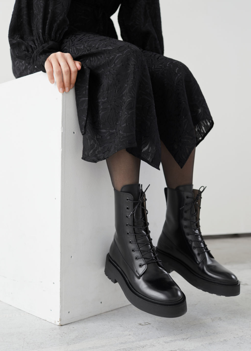 Model front image of Stories chunky platform leather boots in black