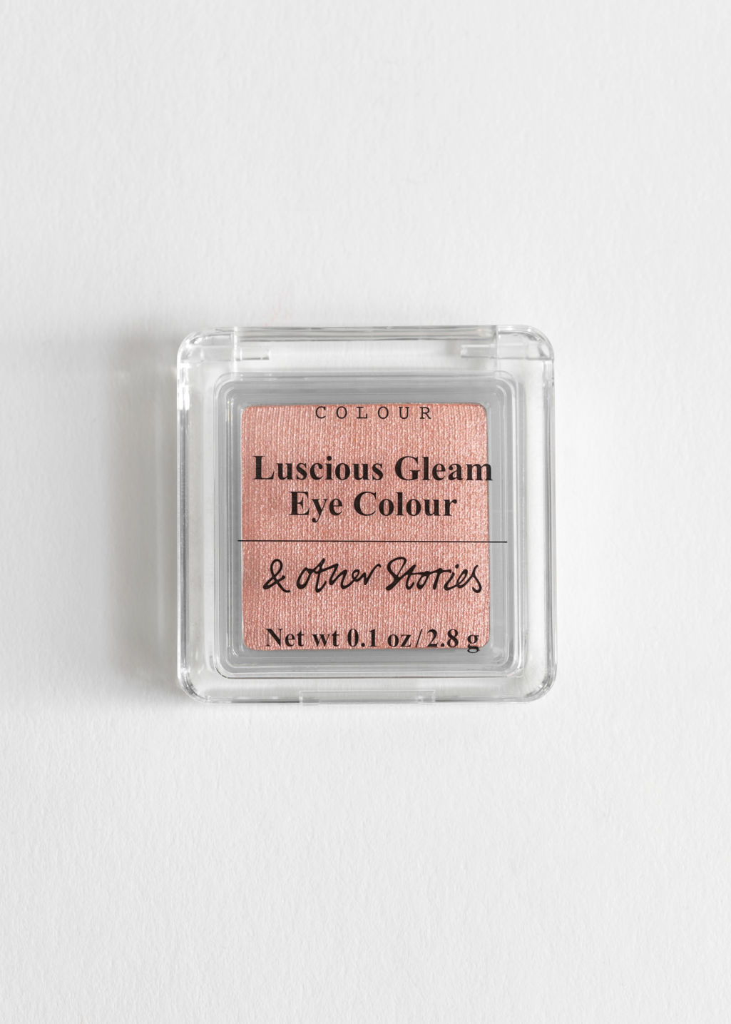Front image of Stories metallic eyeshadow in orange