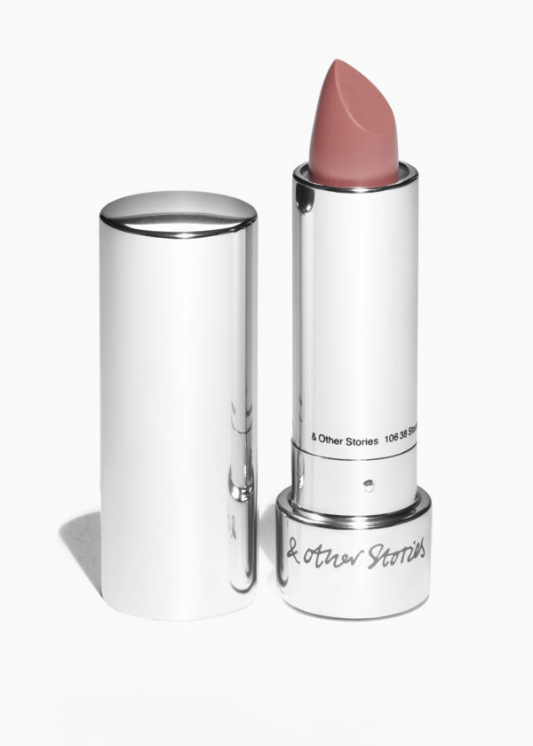 Front image of Stories lipstick in orange