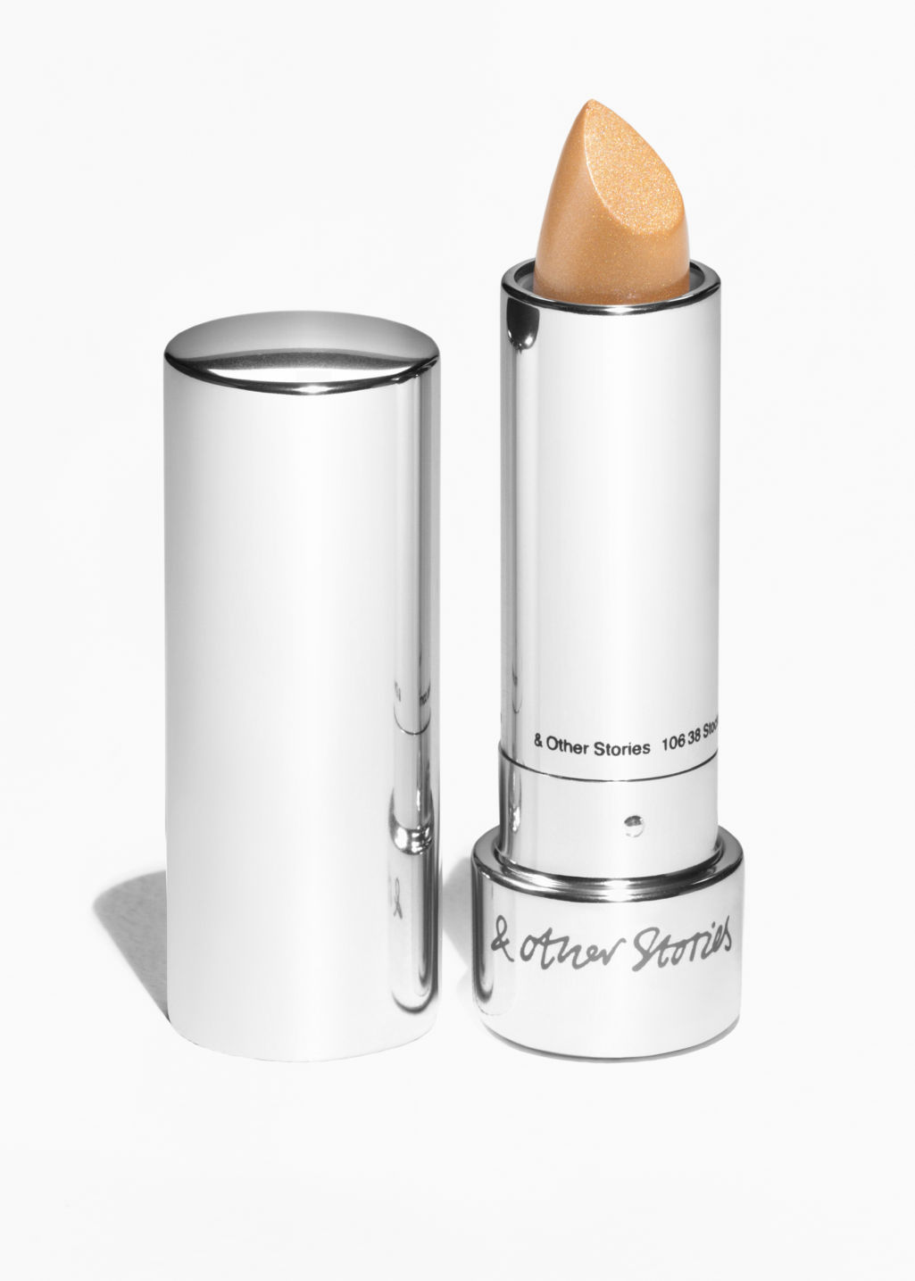 Front image of Stories lipstick in gold