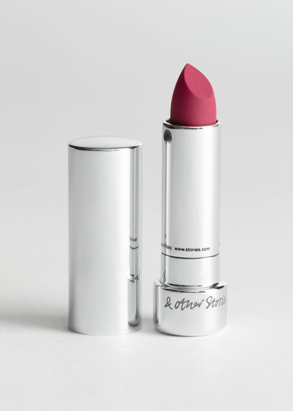Front image of Stories lipstick in pink