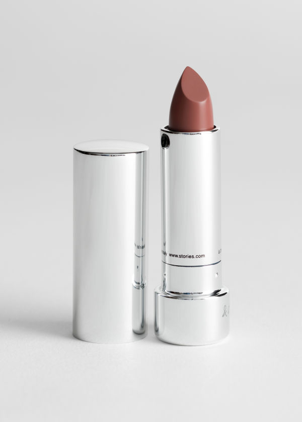 Front image of Stories lipstick in beige