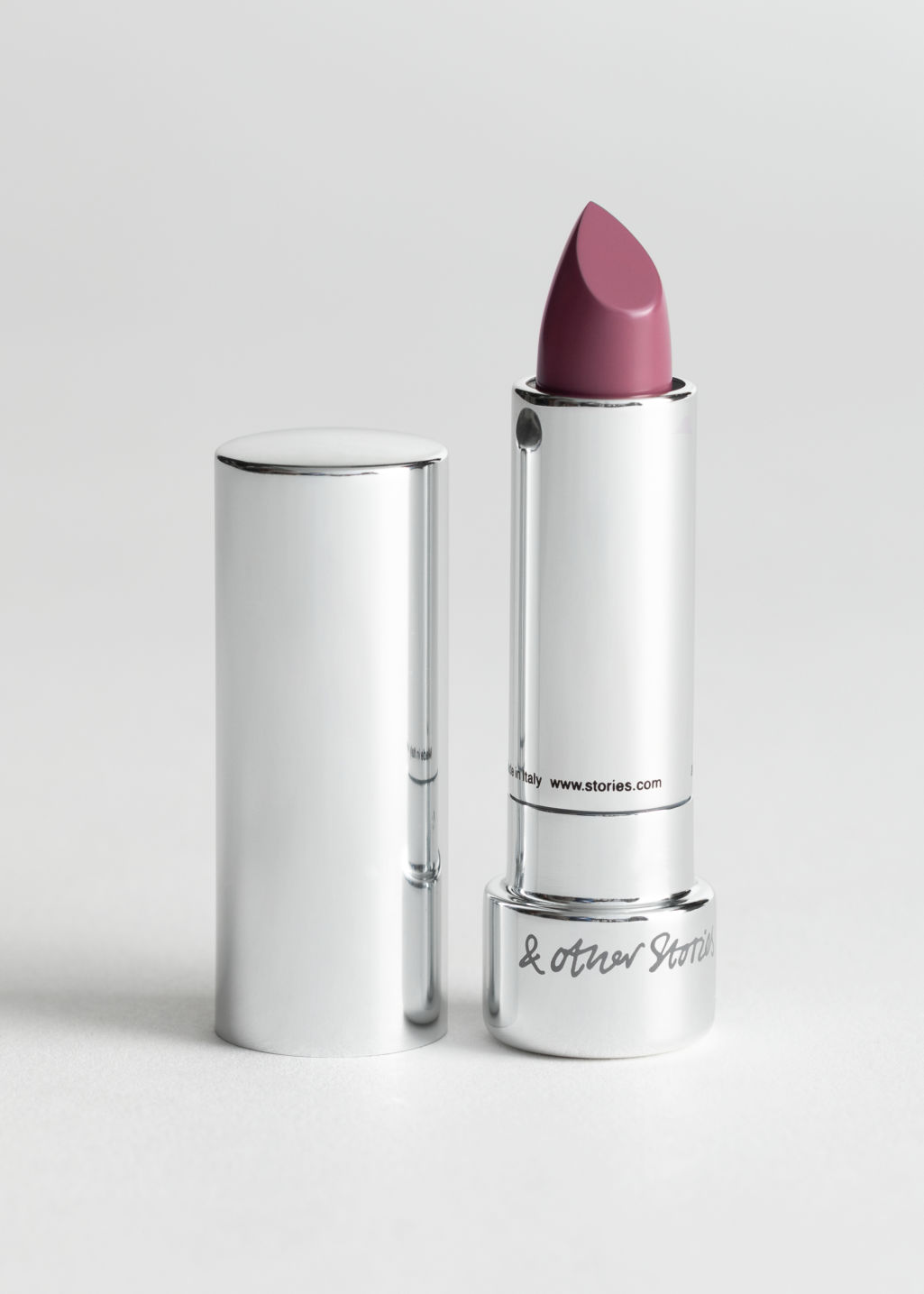 StillLife Front Image of Stories Lipstick in Pink