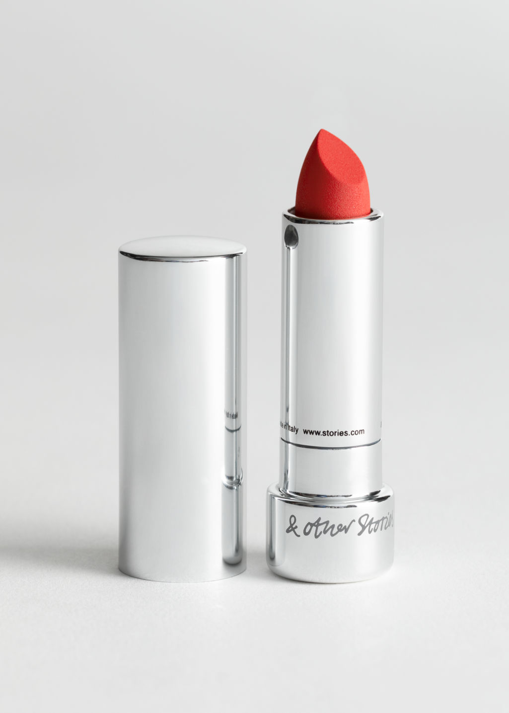 StillLife Front Image of Stories Lipstick in Orange