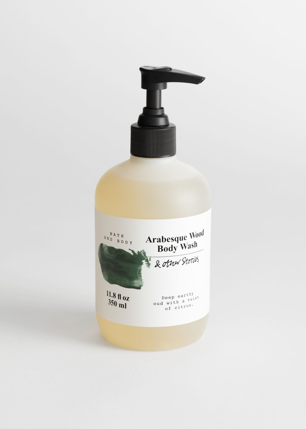 Front image of Stories body wash in green