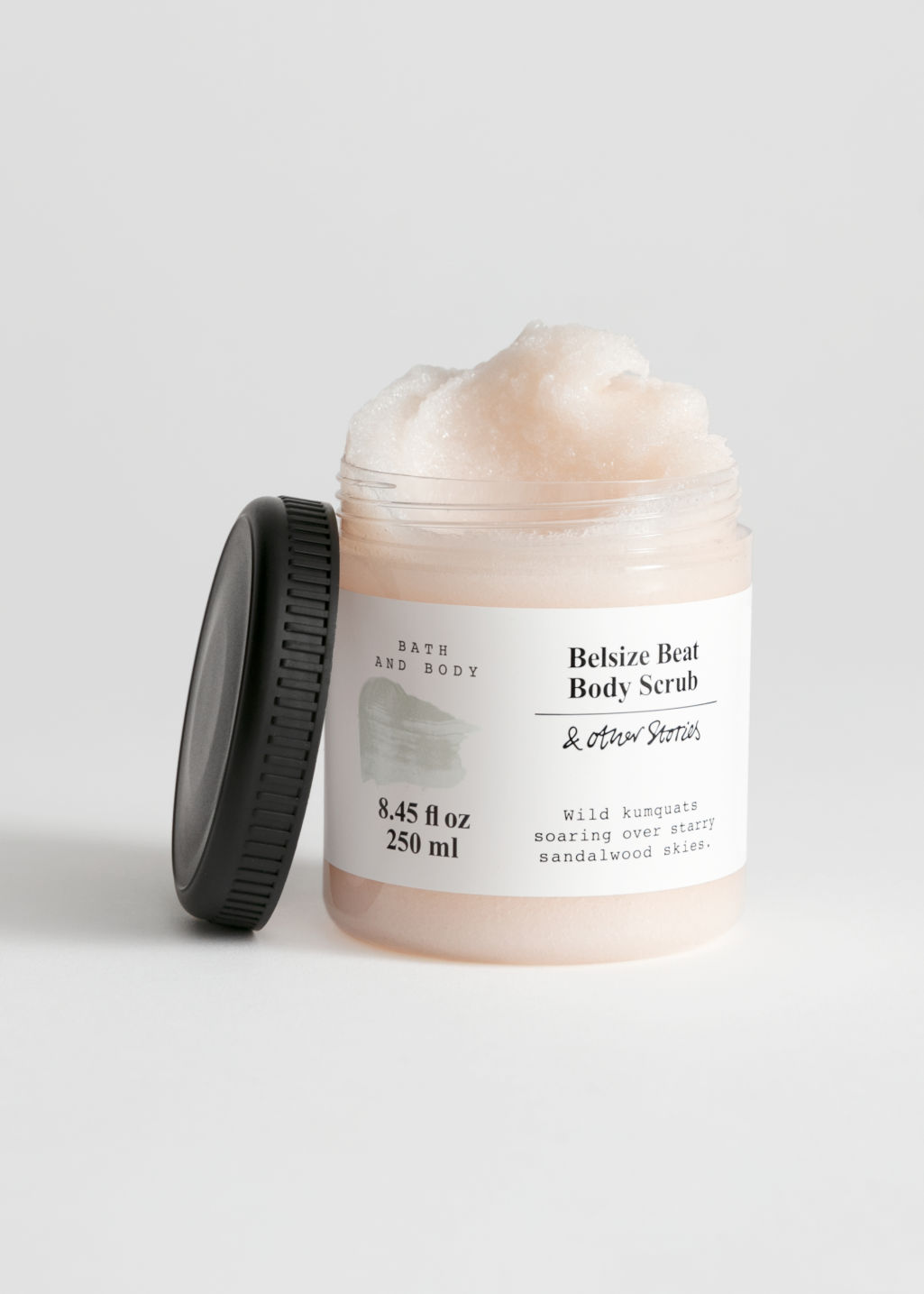 Front image of Stories body scrub in beige