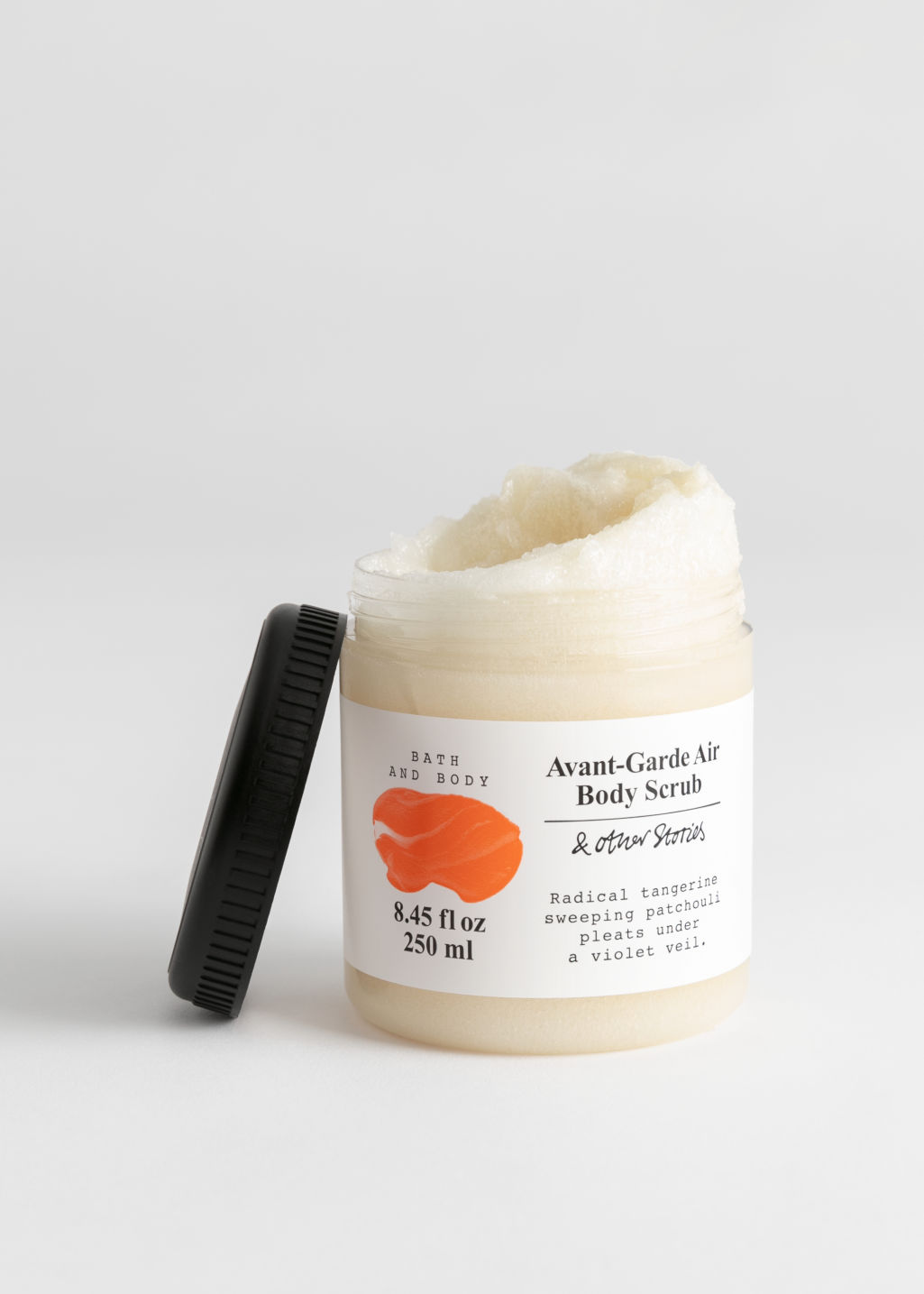 Front image of Stories body scrub in orange