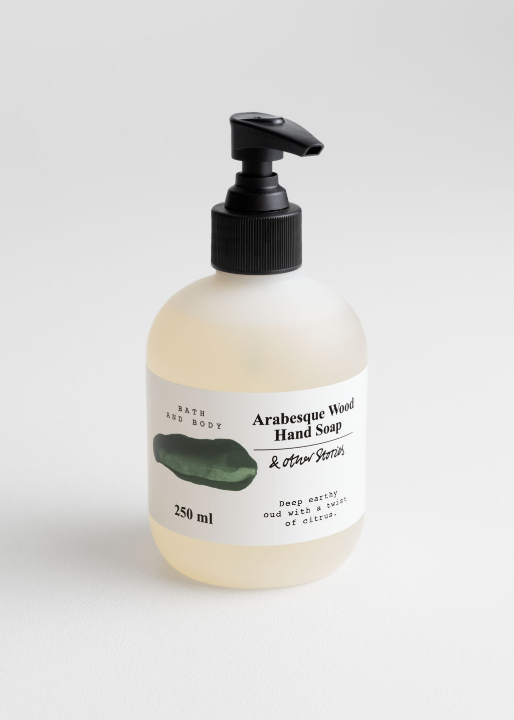Front image of Stories hand soap in green
