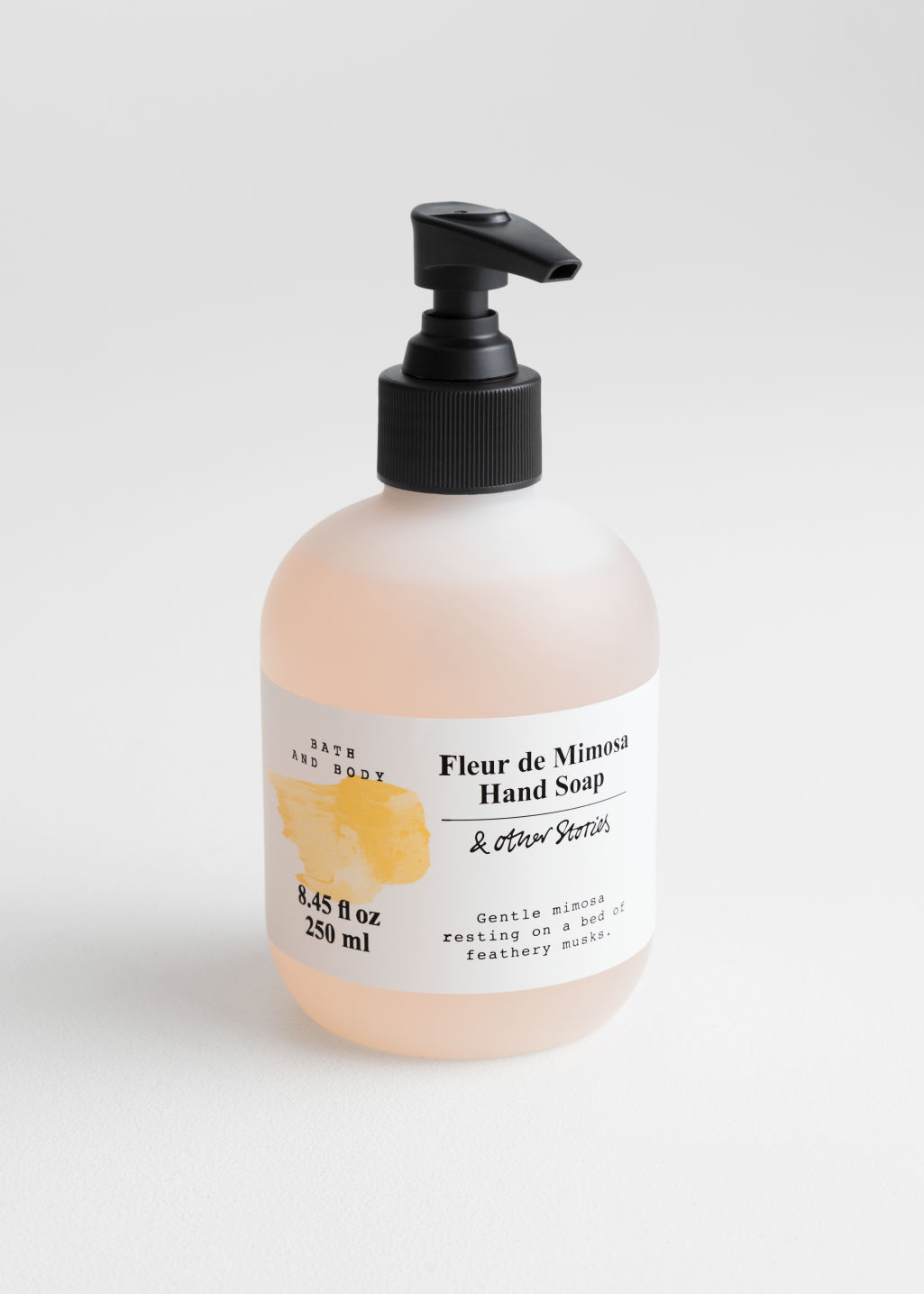Front image of Stories hand soap in orange
