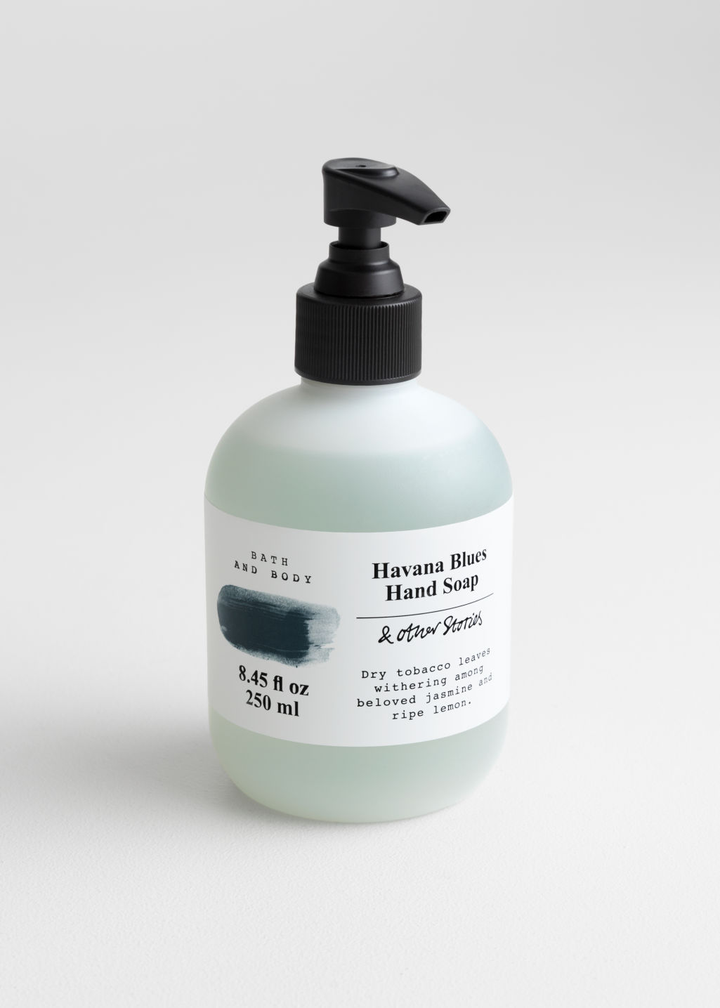 Front image of Stories hand soap in turquoise