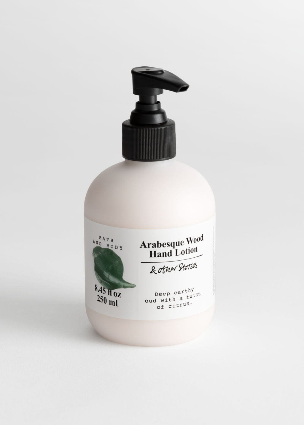 Front image of Stories hand lotion in green