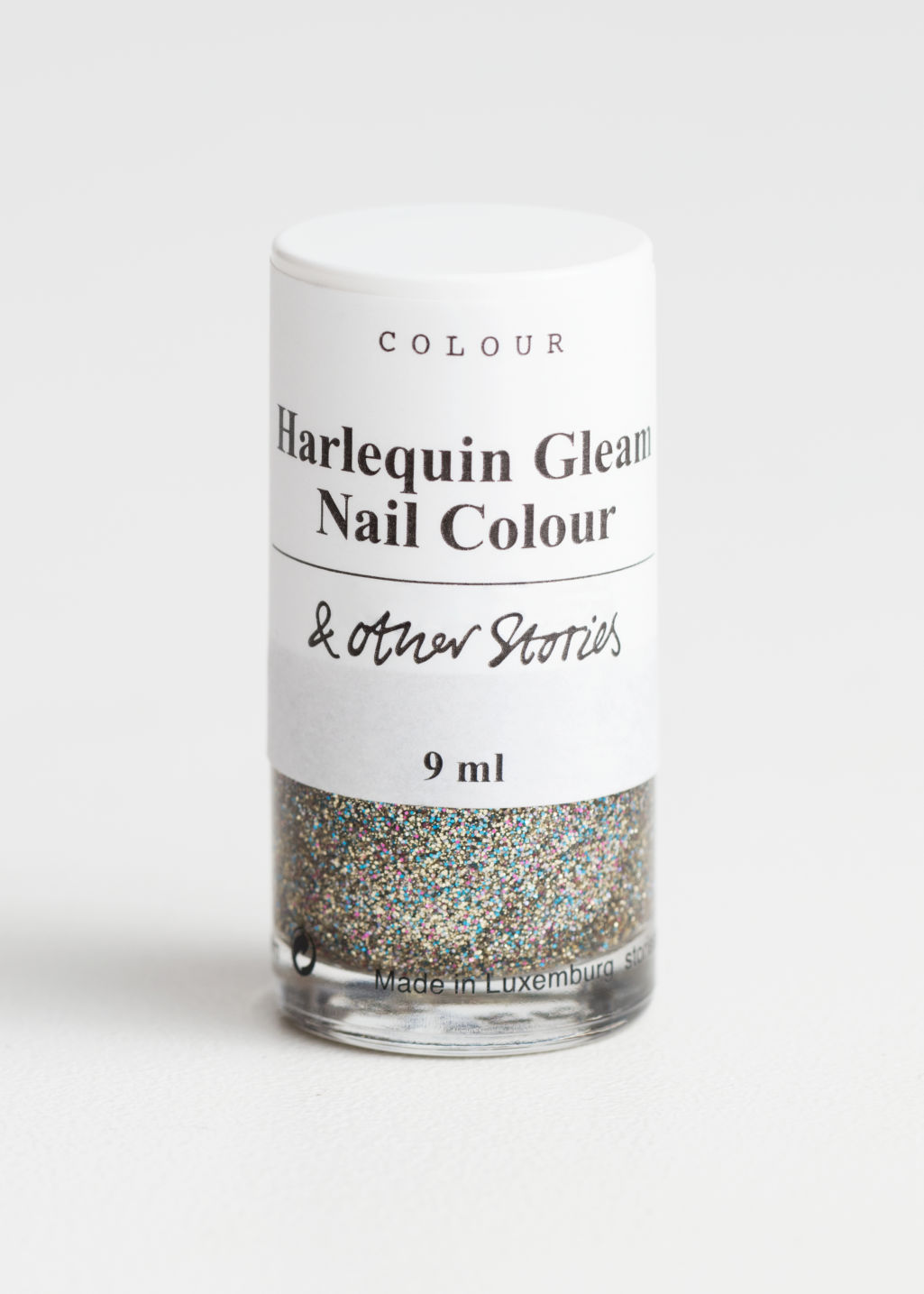 Front image of Stories nail polish in gold