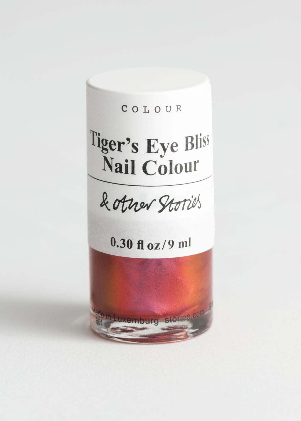 StillLife Front Image of Stories Nail Polish in Orange