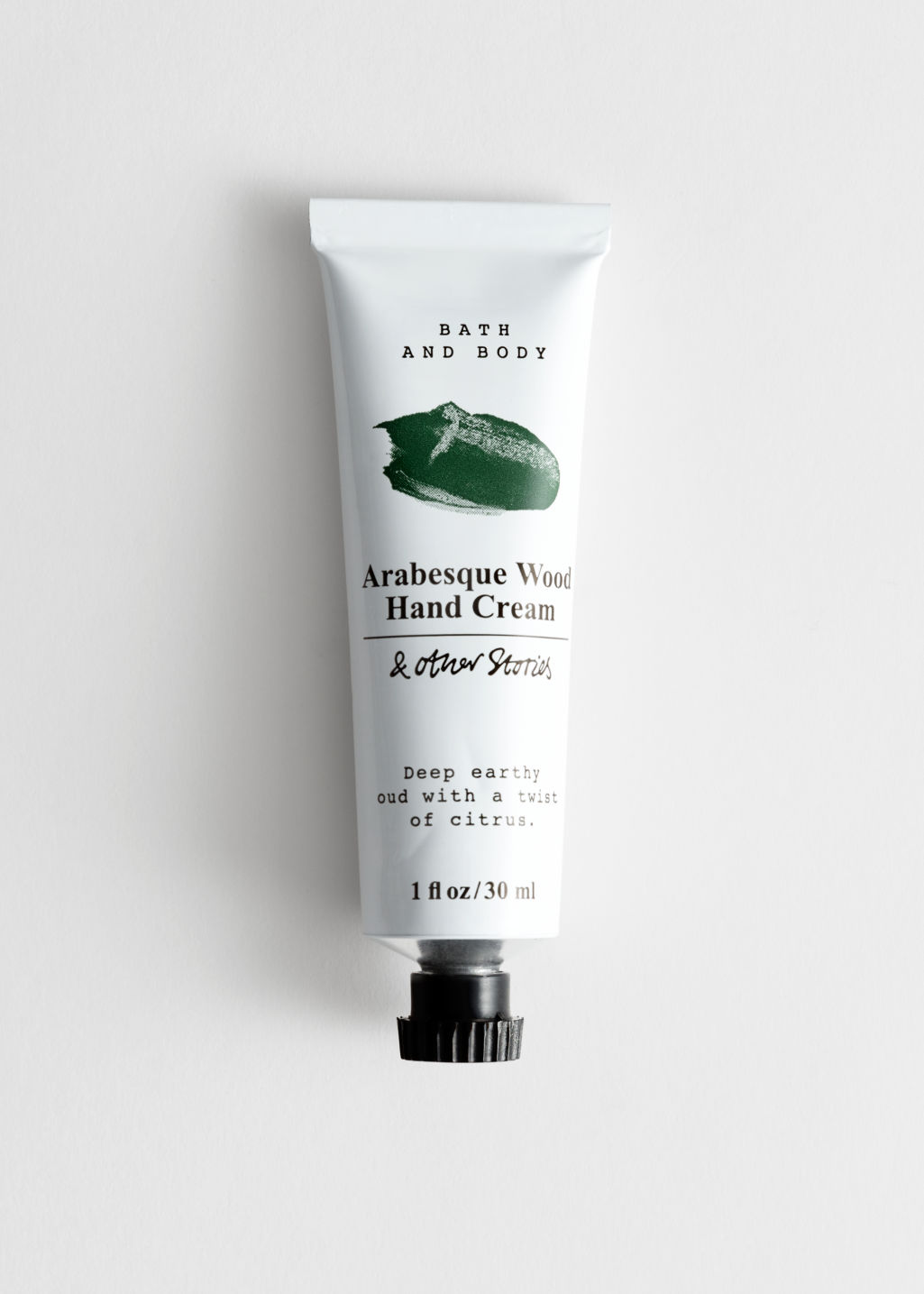 Front image of Stories mini hand cream in green