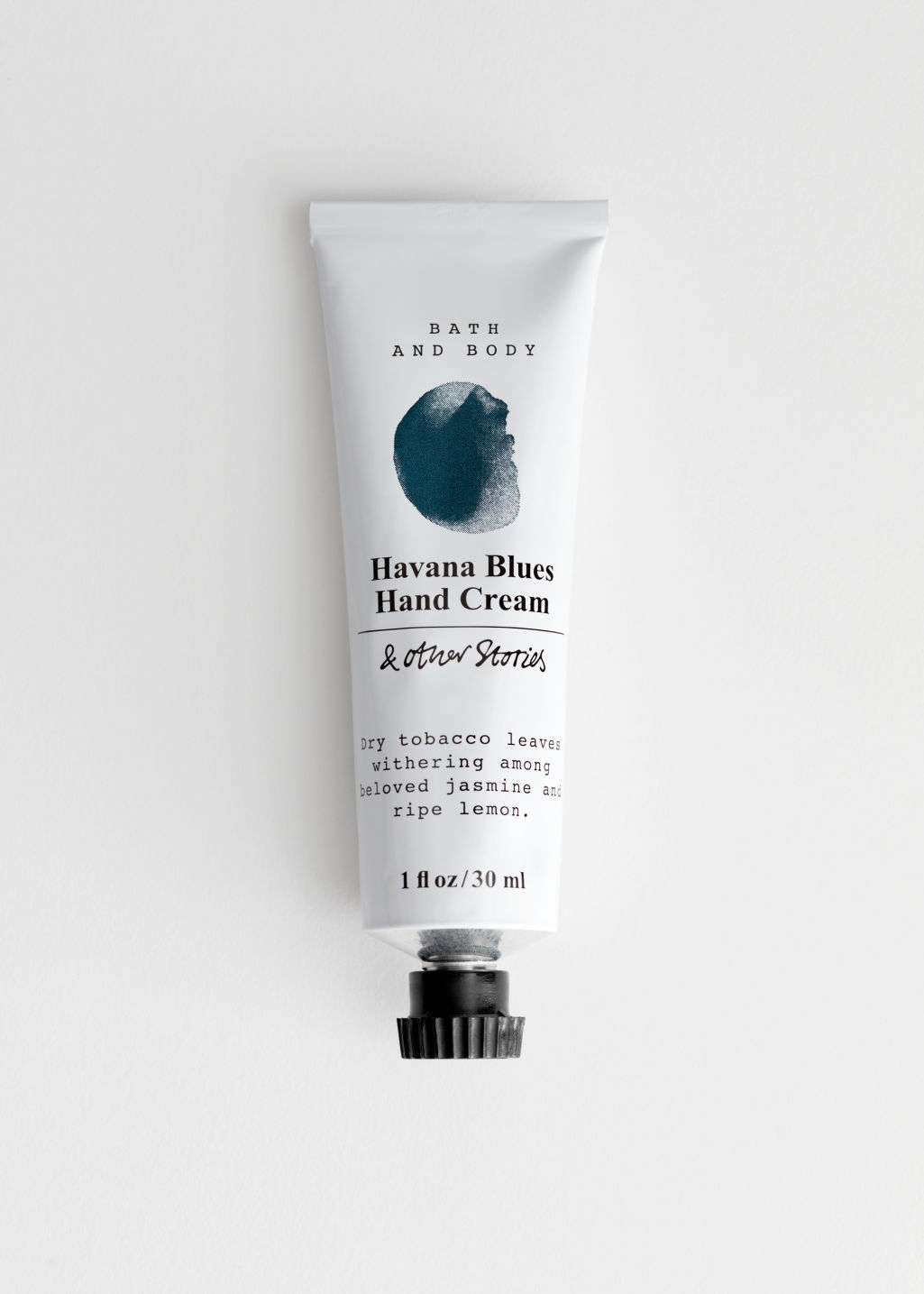 Front image of Stories mini hand cream in turquoise