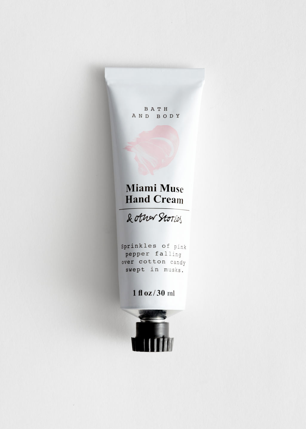 Front image of Stories mini hand cream in pink