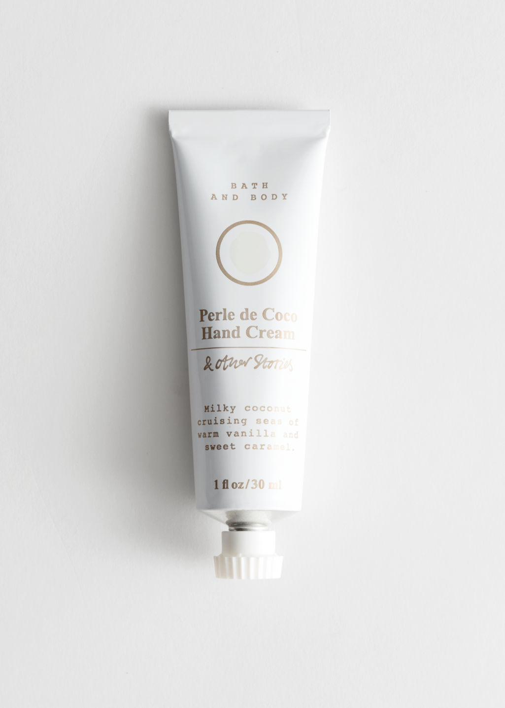 Front image of Stories mini hand cream in white
