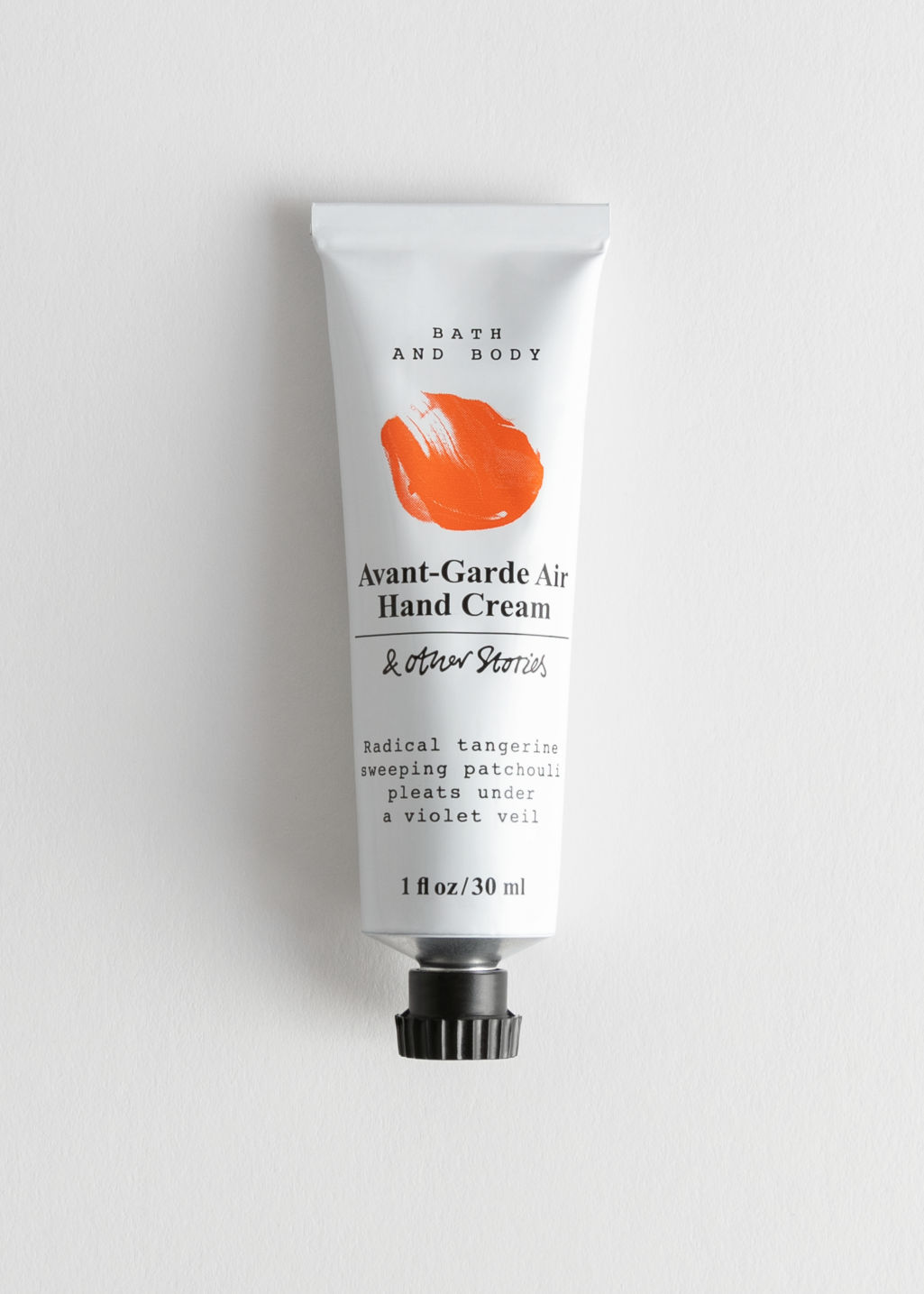 Front image of Stories mini hand cream in orange