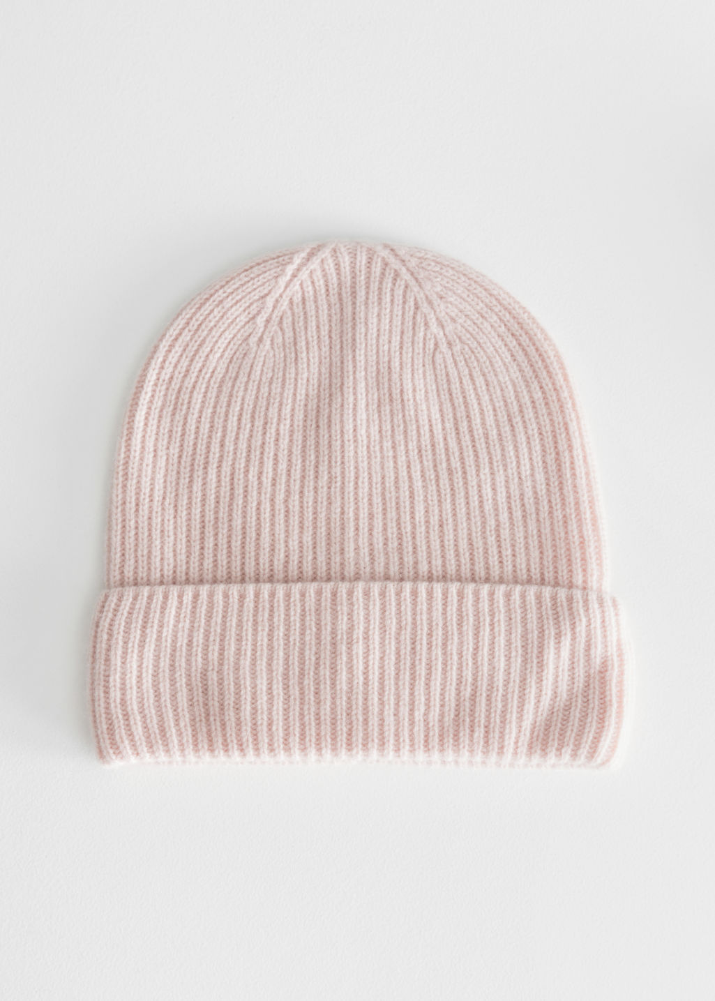 Front image of Stories cashmere beanie in orange