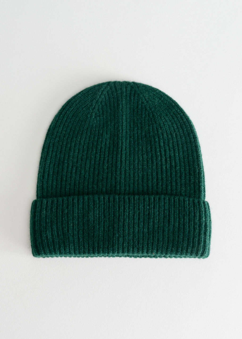 Front image of Stories cashmere beanie in green