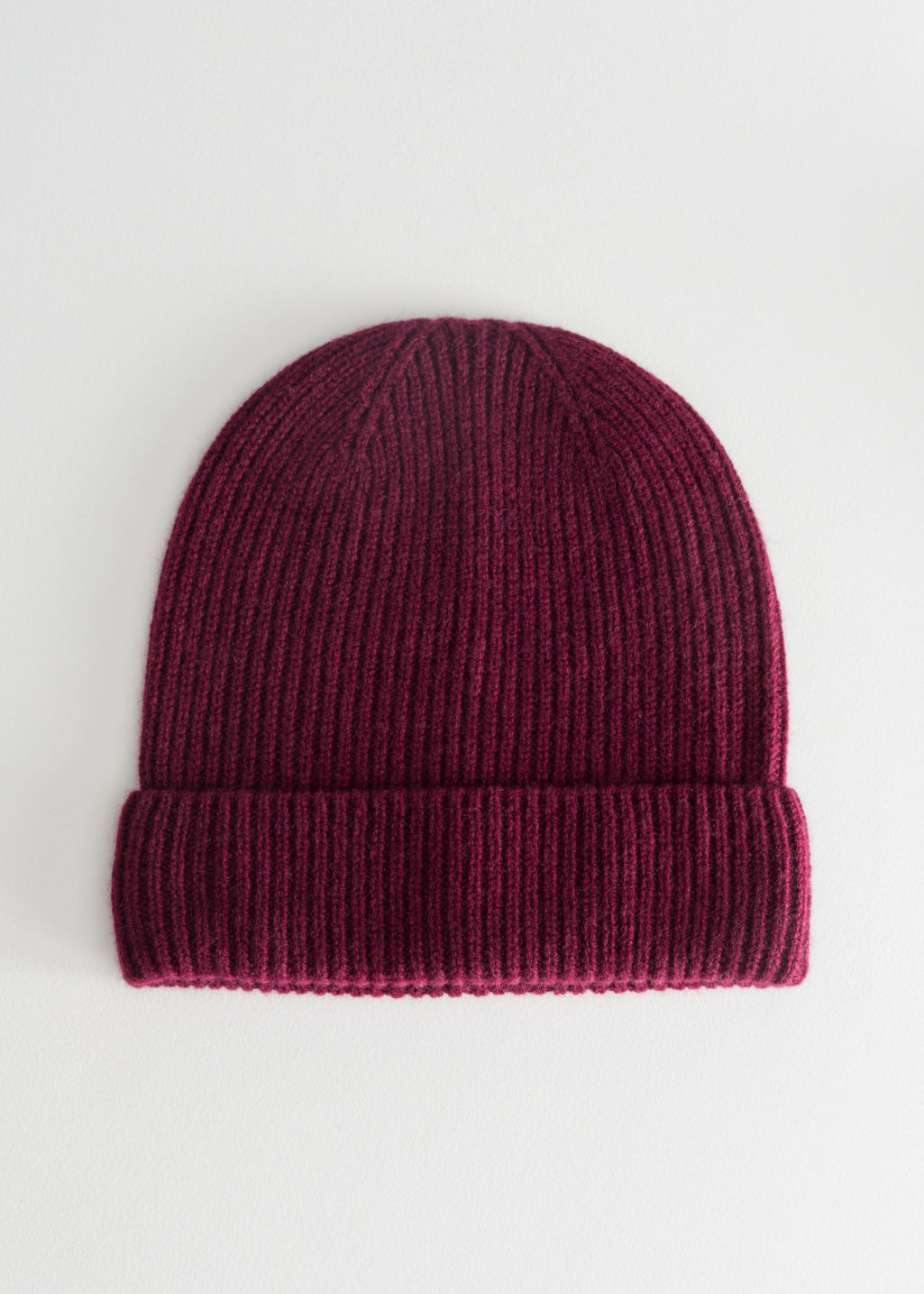 Front image of Stories cashmere beanie in red
