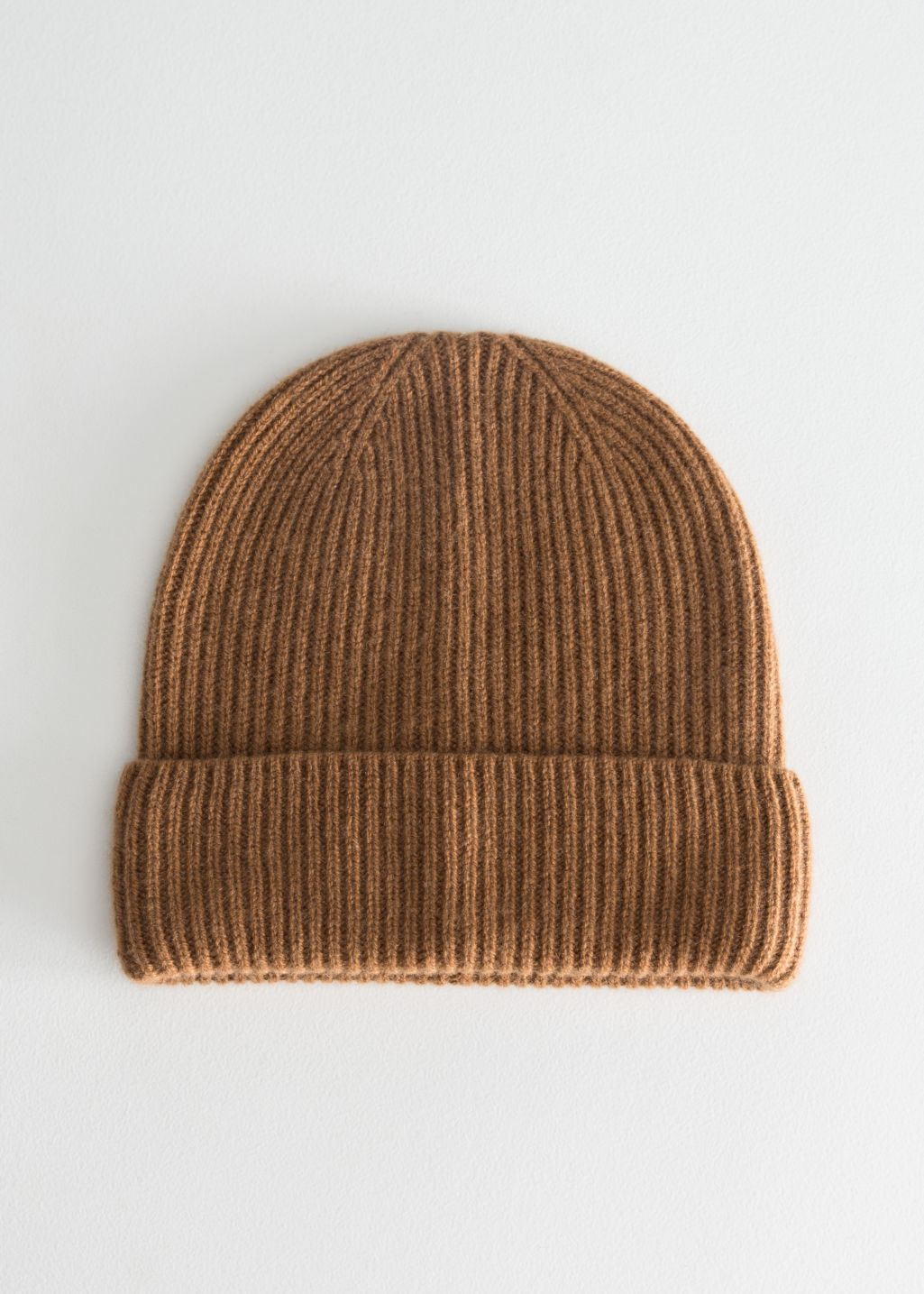 Front image of Stories cashmere beanie in beige