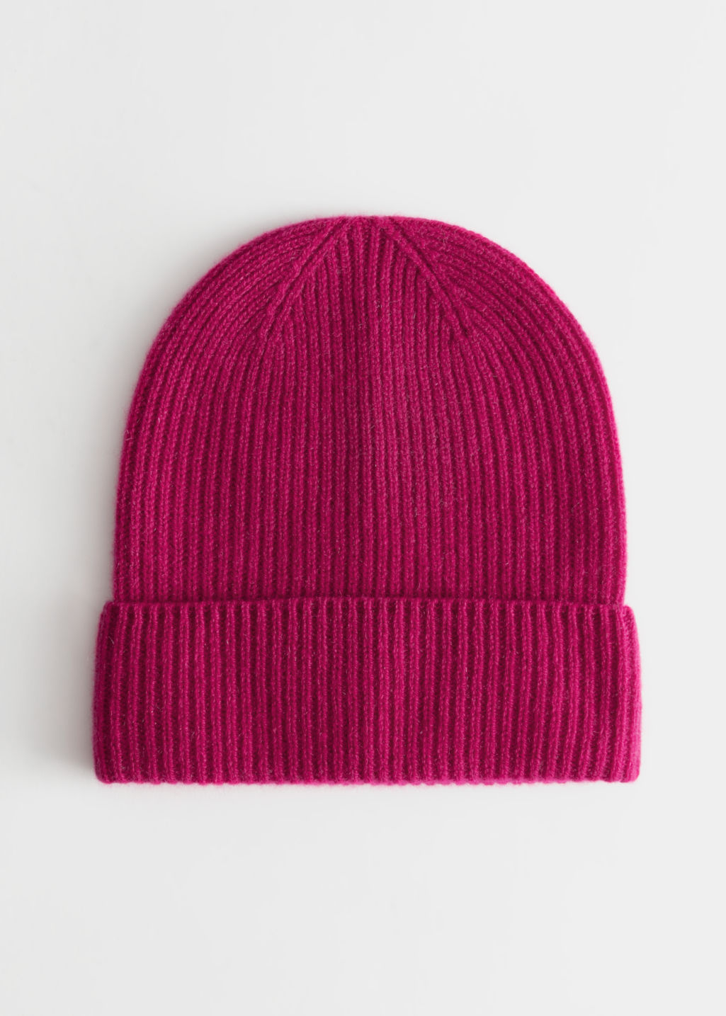 Front image of Stories soft knit beanie in pink