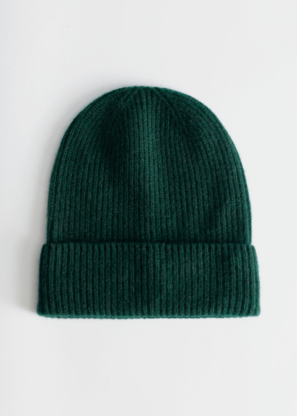 Front image of Stories soft knit beanie in green