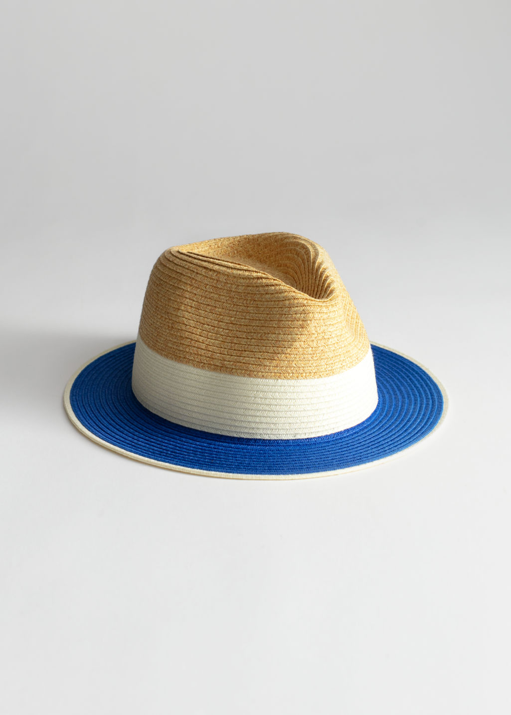 Front image of Stories straw fedora hat in blue