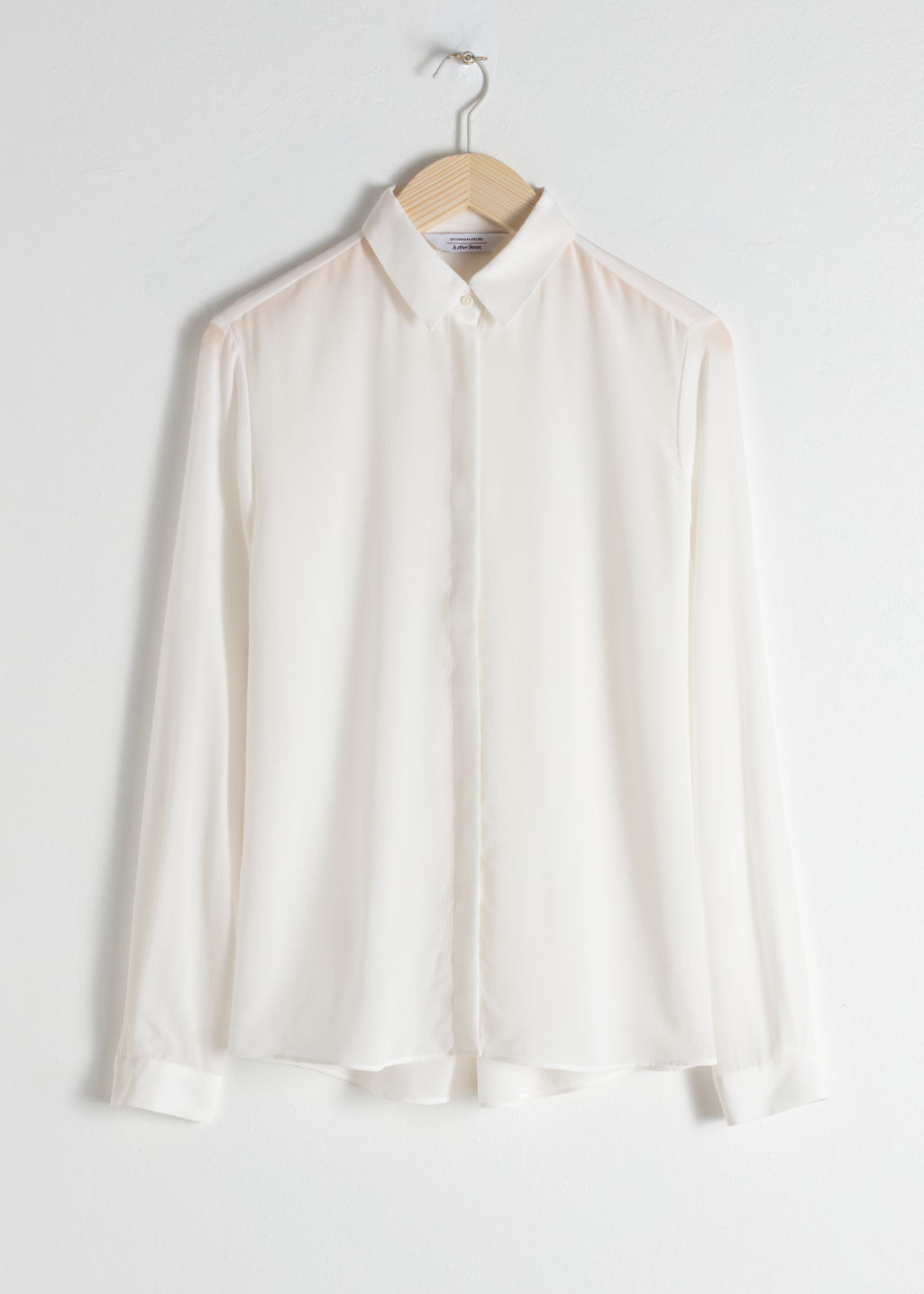 Front image of Stories straight fit silk shirt in white