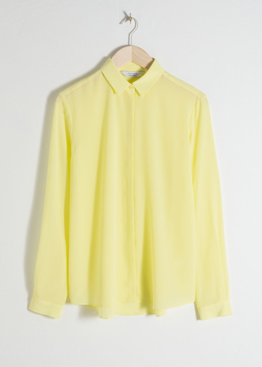 Front image of Stories straight fit silk shirt in yellow