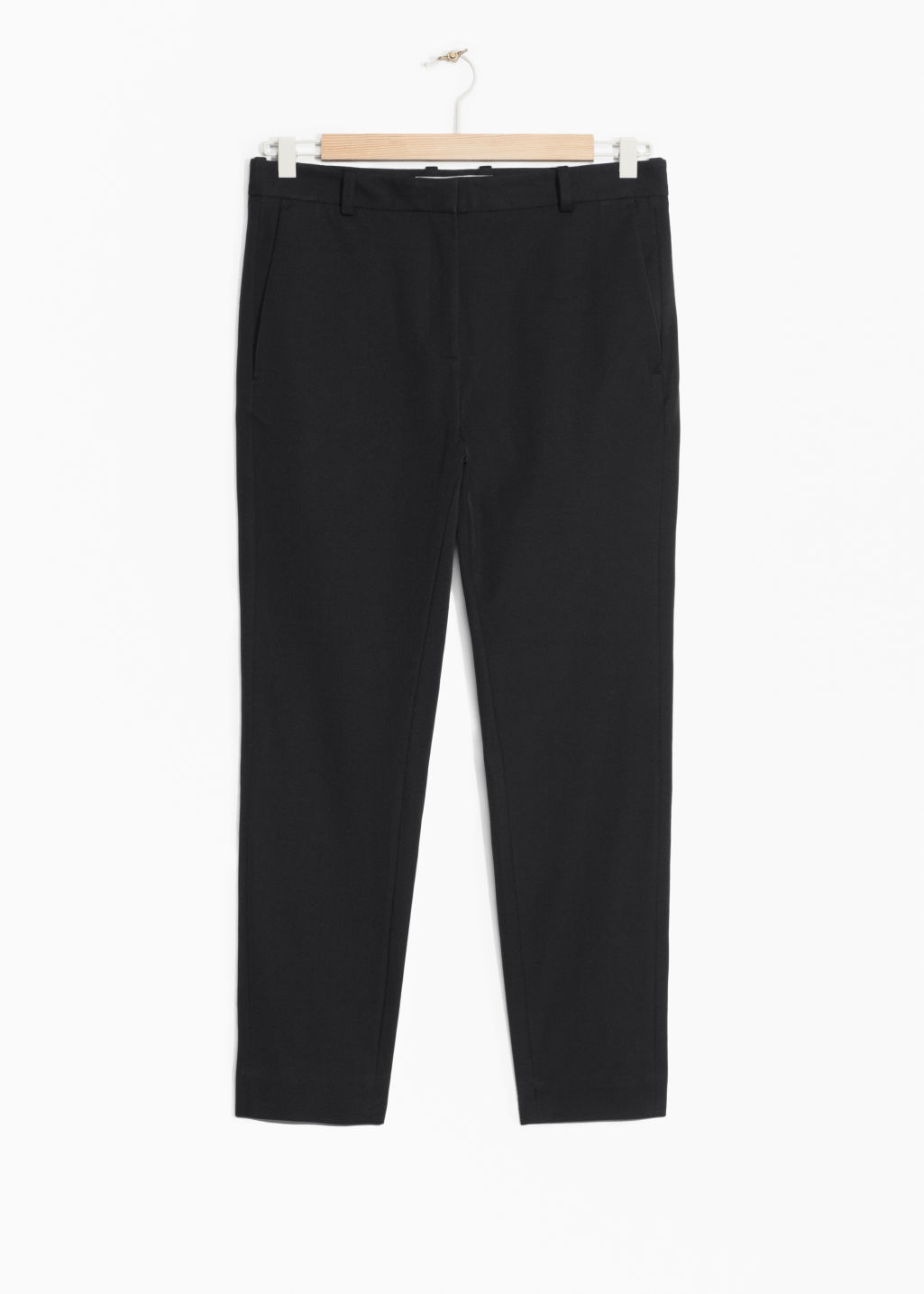 Front image of Stories tailored trousers in black